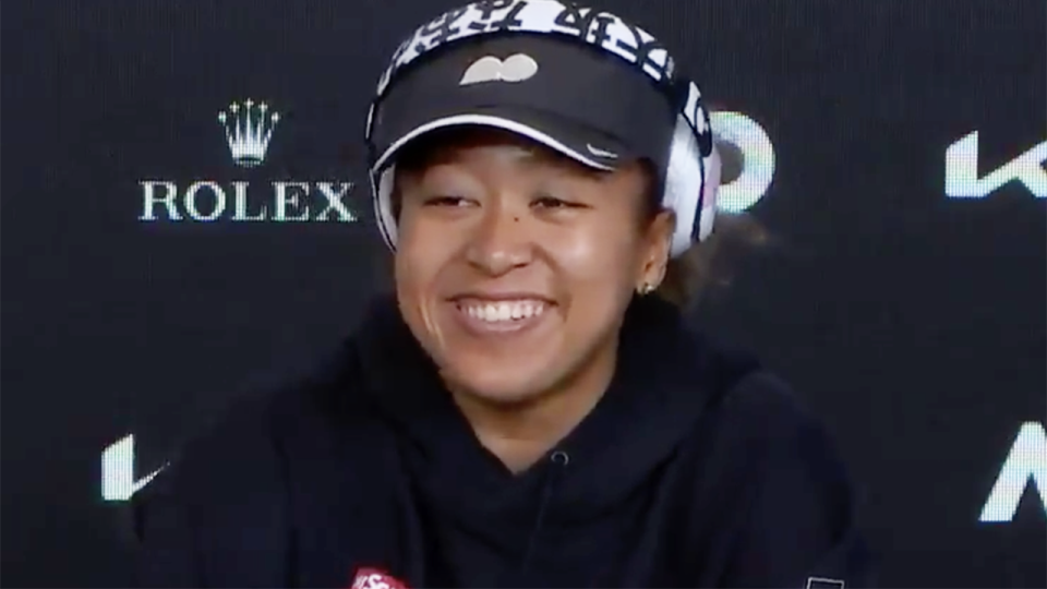 Naomi Osaka's face lit up when her post-match press conference was crashed by rival Iga Swiatek. Picture: Australian Open TV