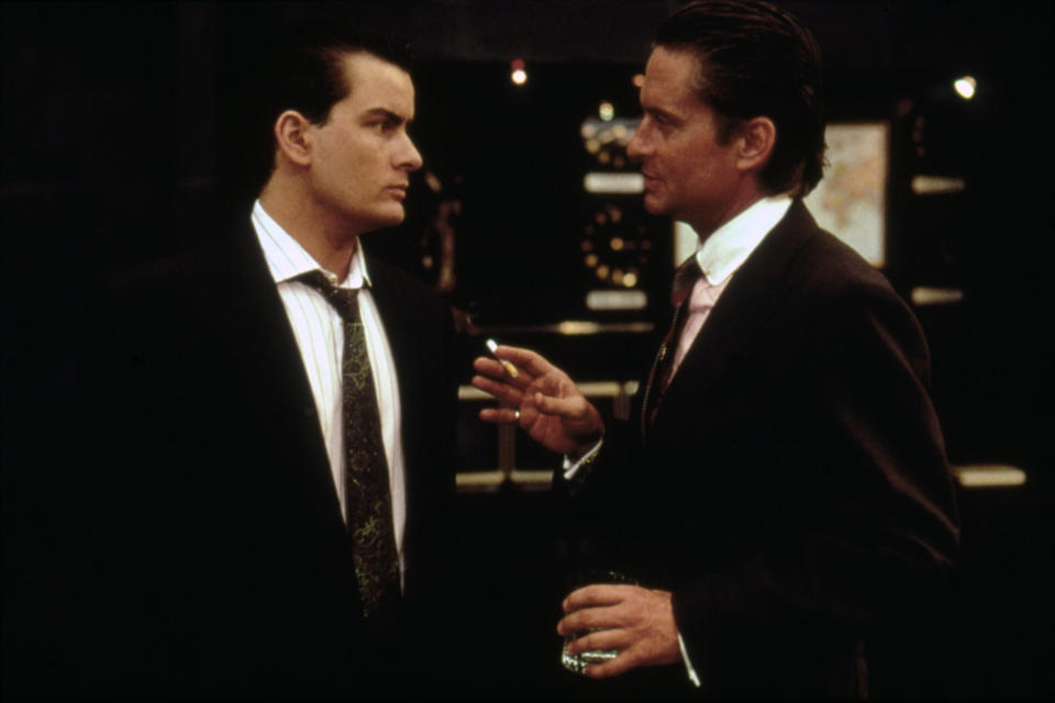 American actors Charlie Sheen and Michael Douglas on the set of Wall Street written and directed by Oliver Stone. (Photo by Sunset Boulevard/Corbis via Getty Images)