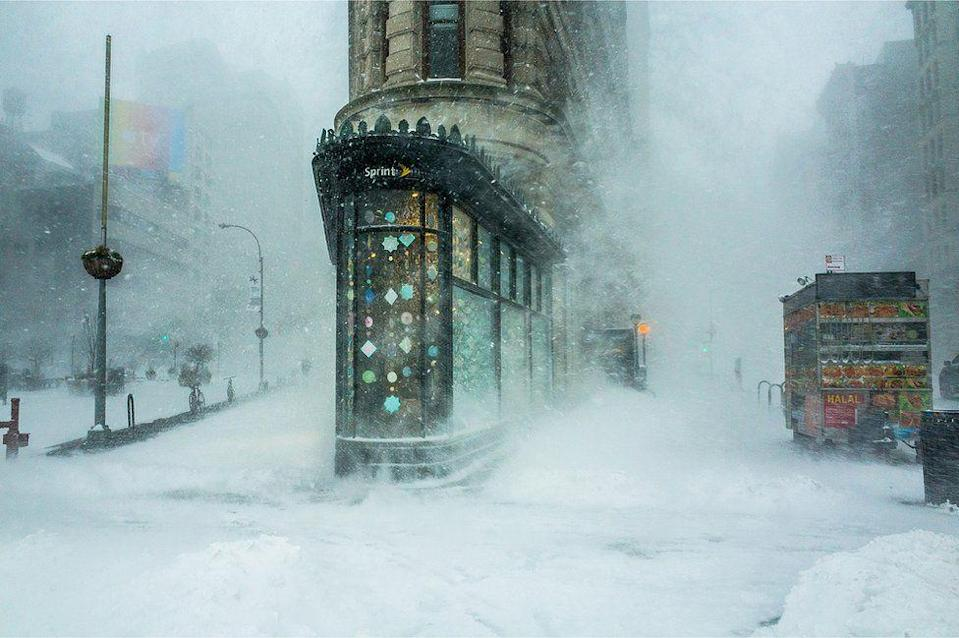 <p>New York City's flatiron building is buffeted by a snowstorm. (Michele Palazzo) </p>