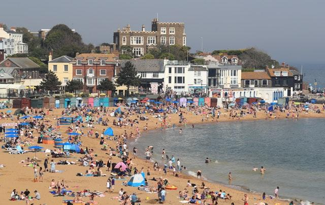 People enjoy the bank holiday sunshine on the beach in Broadstairs, Kent