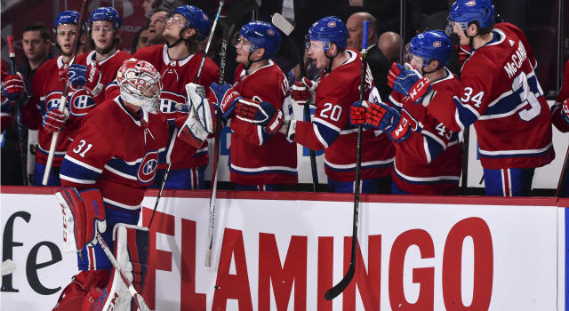 "<a class=""link rapid-noclick-resp"" href=""/nhl/players/3782/"" data-ylk=""slk:Carey Price"">Carey Price</a> is congratulated by teammates for playing in his 557th career game (Photo by Minas Panagiotakis/Getty Images)"