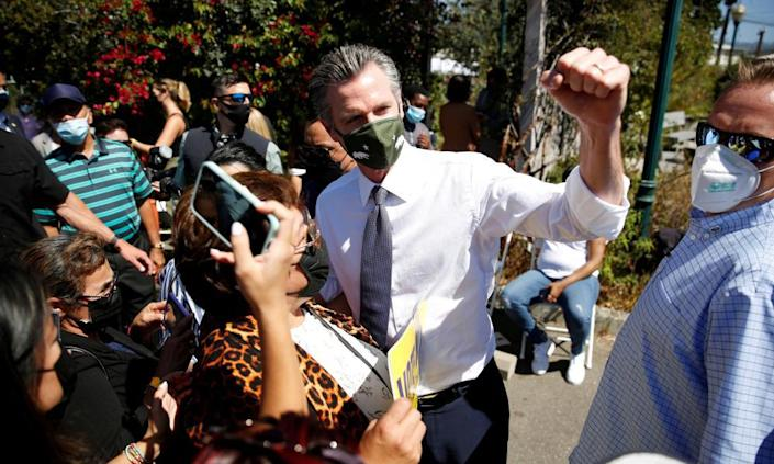 Gavin Newsom takes photos with supporters after a rally in Oakland on Saturday.