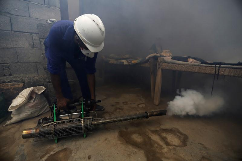 Health worker fumigates a residential area to curb the spread of dengue fever in Hodeidah