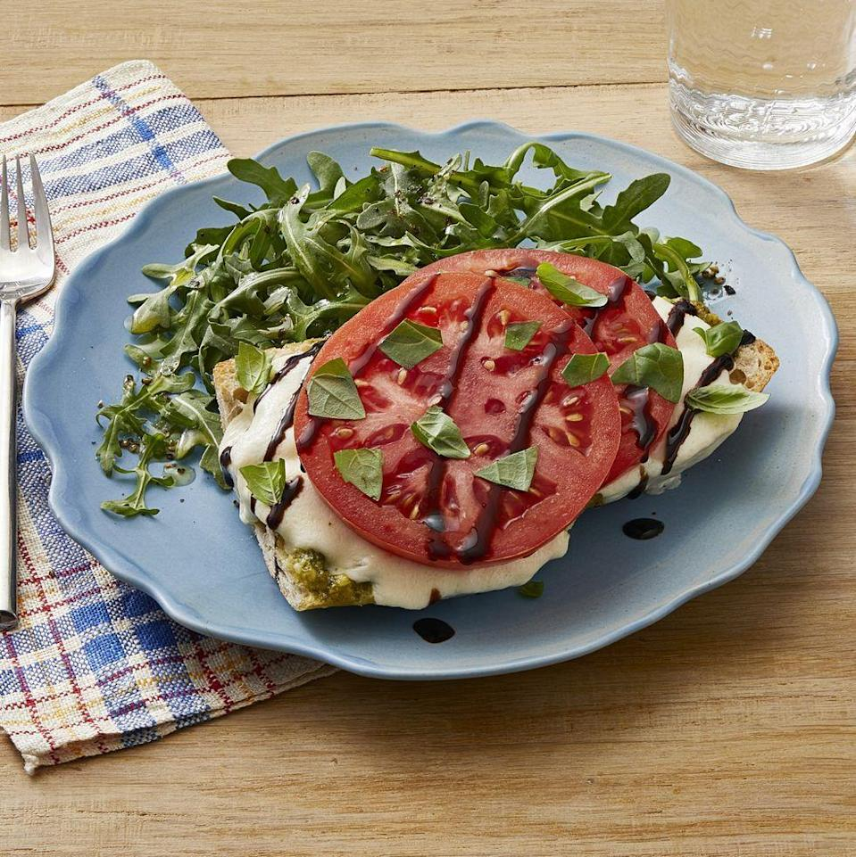 """<p>If you're a fan of caprese salad—fresh, thick slices of tomato and creamy mozzarella—you'll love it on a piece of toasted Italian bread. It's a simple weeknight dinner for the whole family. </p><p><a href=""""https://www.thepioneerwoman.com/food-cooking/recipes/a35951720/caprese-french-bread-pizzas-recipe/"""" rel=""""nofollow noopener"""" target=""""_blank"""" data-ylk=""""slk:Get Ree's recipe."""" class=""""link rapid-noclick-resp""""><strong>Get Ree's recipe. </strong></a></p><p><a class=""""link rapid-noclick-resp"""" href=""""https://go.redirectingat.com?id=74968X1596630&url=https%3A%2F%2Fwww.walmart.com%2Fsearch%2F%3Fquery%3Dbread%2Bknives&sref=https%3A%2F%2Fwww.thepioneerwoman.com%2Ffood-cooking%2Fmeals-menus%2Fg36500577%2Ftomato-recipes%2F"""" rel=""""nofollow noopener"""" target=""""_blank"""" data-ylk=""""slk:SHOP BREAD KNIVES"""">SHOP BREAD KNIVES</a></p>"""
