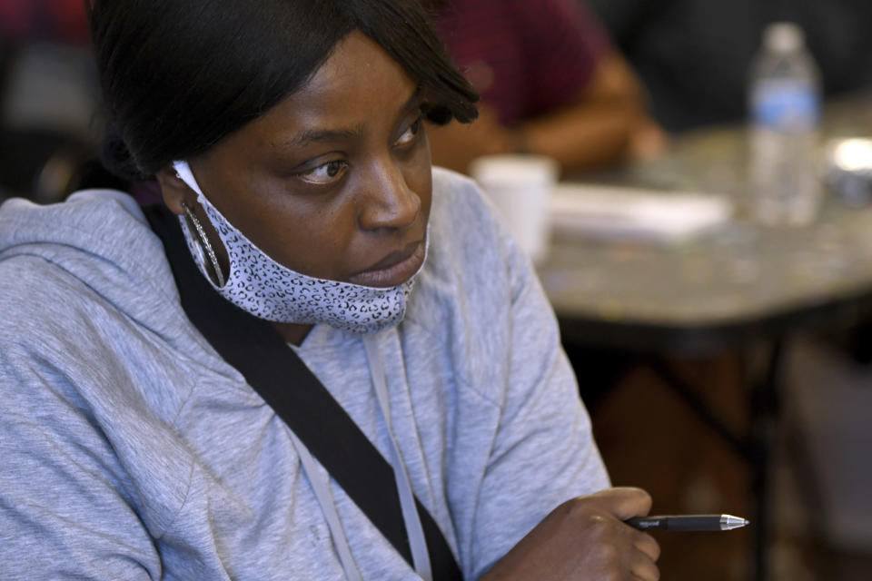 Desiree Humphrey attends a marijuana social equity class in Denver on Saturday, April 3, 2021. The class, run by the advocacy group The Color of Cannabis, helps students navigate Colorado's social equity application process and connects them with marijuana industry leaders. Colorado's social equity program is aimed at correcting past wrongs from the war on drugs, which disproportionately affected minorities.(AP Photo/Thomas Peipert)