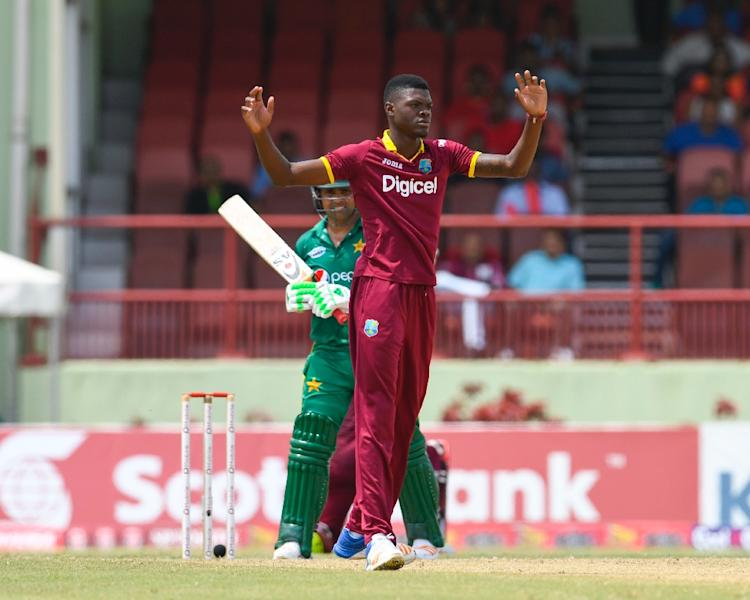 Kamran Akmal (L) of Pakistan dismiss by Alzarri Joseph (R) of West Indies during the 2nd ODI match between West Indies and Pakistan (AFP Photo/Randy BROOKS)