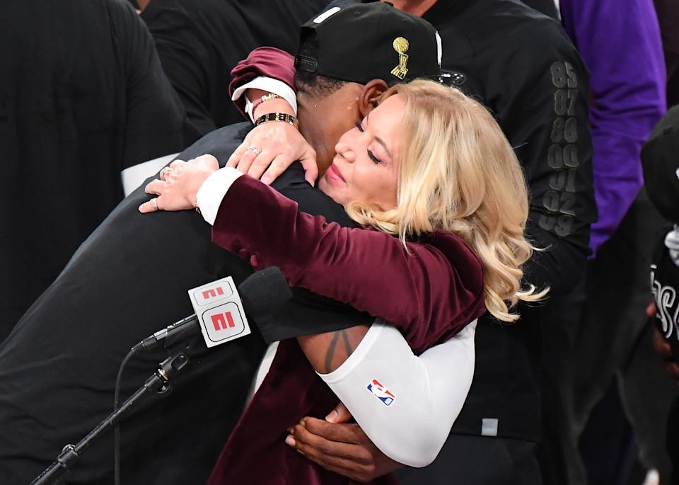 Lakers owner Jeannie Buss gets a hug from LeBron James