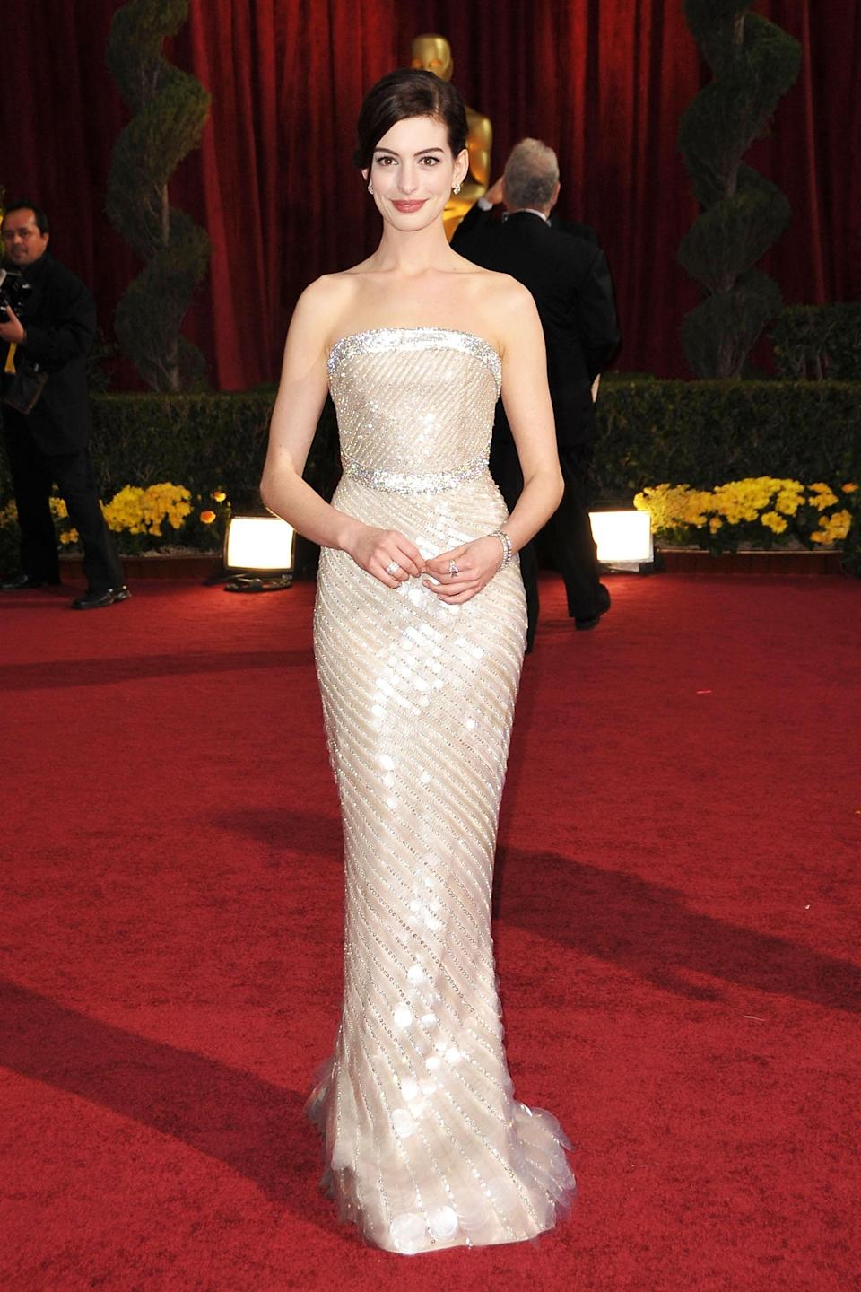 """<strong><h2>Anne Hathaway, 2009</h2></strong><br>Is it just us, or does Anne Hathaway look like an actual Oscar in this fitted Armani Privé dress?<br><br><em>Anne Hathaway in Armani Privé.</em><span class=""""copyright"""">Photo: John Shearer/WireImage/Getty Images. </span>"""