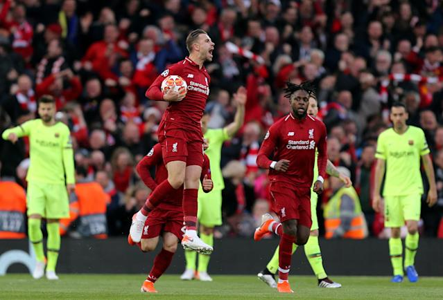 Liverpool's Jordan Henderson celebrates after Divock Origi scored the opening goal during the UEFA Champions League Semi Final second leg match between Liverpool and Barcelona at Anfield on May 7, 2019 in Liverpool, England. (Photo by Rich Linley - CameraSport via Getty Images)