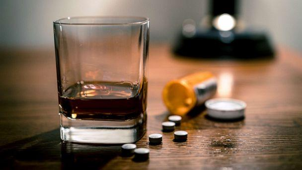 PHOTO: A glass of alcohol and some pills are seen on a table in this stock photo. (STOCK PHOTO/Getty Images)