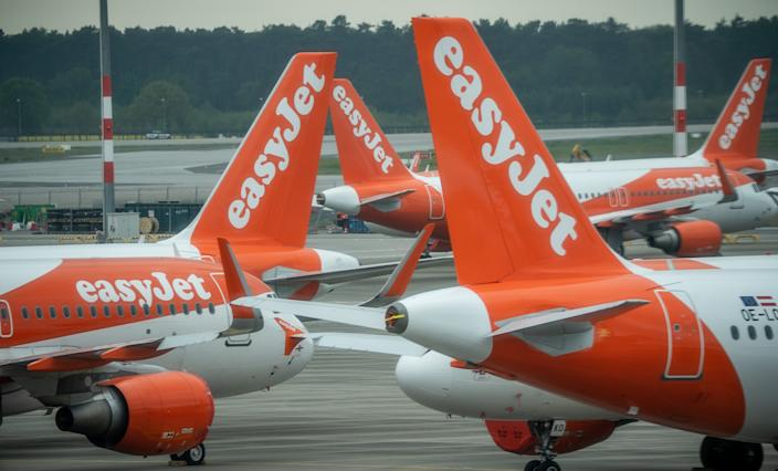 29 April 2020, Brandenburg, Schönefeld: Easy Jet aircraft are parked on the apron of the new Berlin-Brandenburg Willy-Brandt Airport. At meetings of the Supervisory Board and the shareholders' meeting of Flughafen Berlin Brandenburg GmbH, the temporary closure of Tegel Airport is to be discussed, among other things. Photo: Michael Kappeler/dpa (Photo by Michael Kappeler/picture alliance via Getty Images)