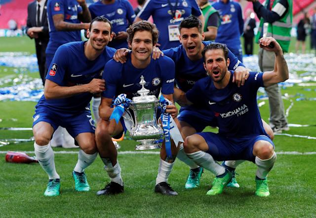 Soccer Football - FA Cup Final - Chelsea vs Manchester United - Wembley Stadium, London, Britain - May 19, 2018 Chelsea's Davide Zappacosta, Marcos Alonso, Alvaro Morata and Cesc Fabregas celebrate with the the trophy after winning the FA Cup final Action Images via Reuters/Andrew Couldridge