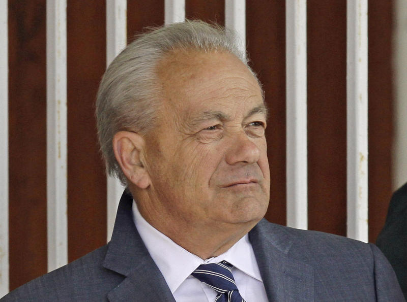 FILE - In this March 22, 2014, file photo, horse trainer Jerry Hollendorfer stands in the paddock at Turfway Park in Florence, Ky. Hollendorfer was banned by the ownership of Santa Anita on Saturday, June 22, 2019, after a fourth horse from his stable died--and the 30th overall--at the Southern California track. (AP Photo/Garry Jones, File)