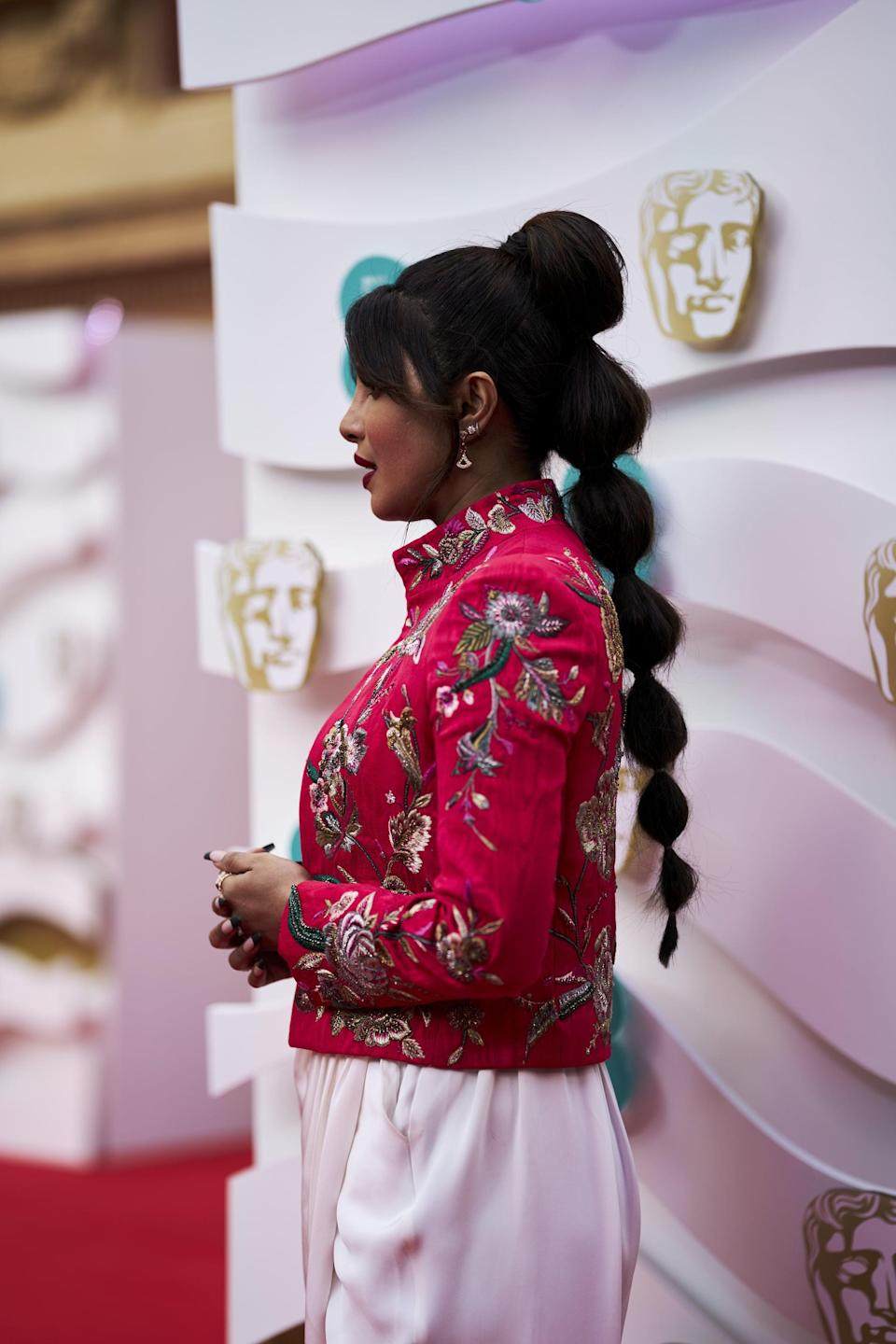 "<p>Chopra Jonas decided to try out one of 2021's biggest hairstyle trends - the <a href=""https://www.popsugar.com/beauty/priyanka-chopra-bubble-braid-hairstyle-bafta-awards-48264070"" class=""link rapid-noclick-resp"" rel=""nofollow noopener"" target=""_blank"" data-ylk=""slk:bubble ponytail"">bubble ponytail</a> - for the evening. To get that gorgeous volume, hairstylist Luke Pluck Rose sprayed Anomaly Dry Shampoo throughout the tail before adding the hair grips.</p>"