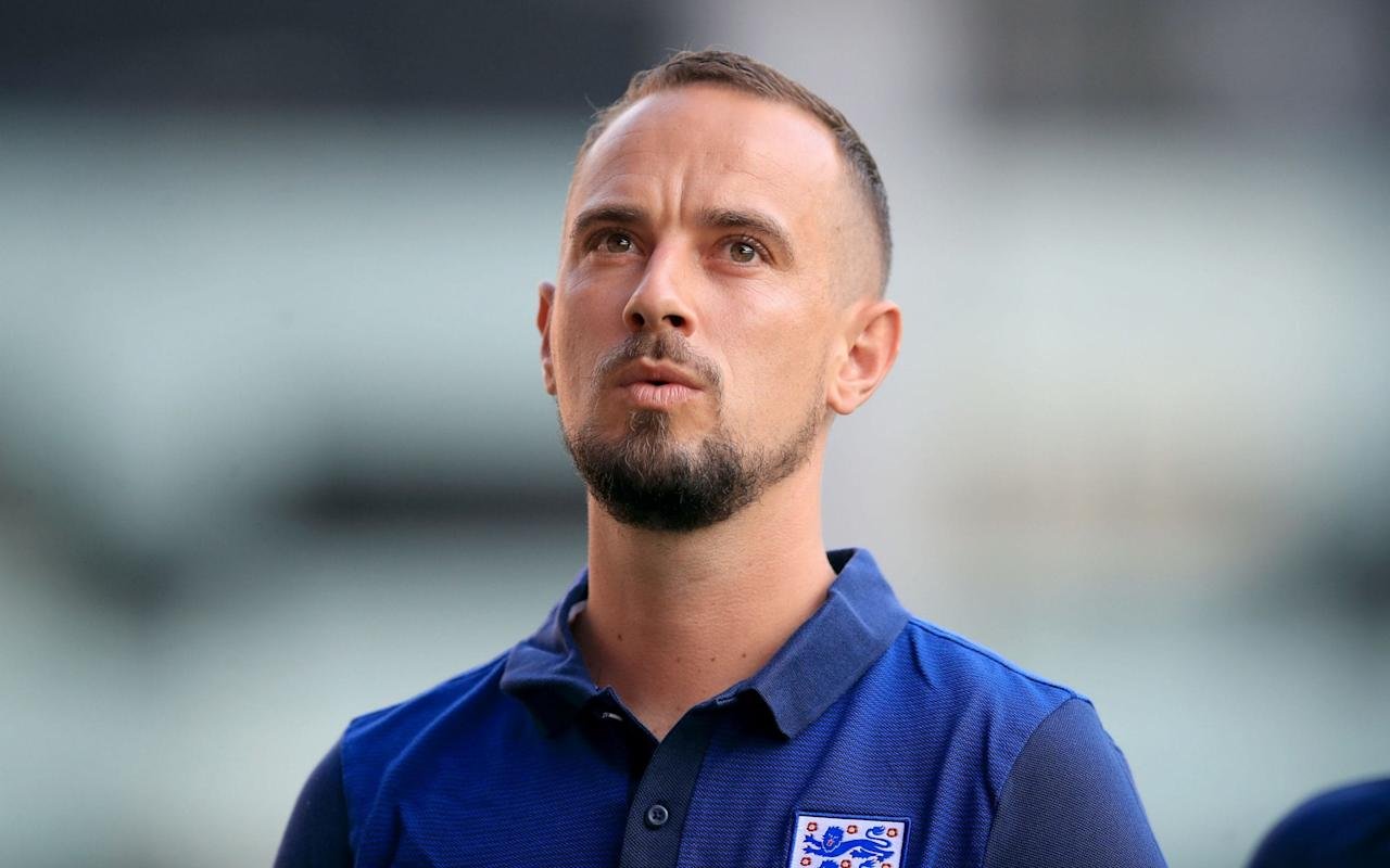 """A defiant Football Association will continue to give their full backing to England women's manager, Mark Sampson, despite fresh allegations that he made a racist remark towards England striker Eni Aluko. The game's governing body will also reject calls, led by the Professional Footballers Association, for a fresh investigation into Aluko's allegations that she was a victim of bullying during her time in the England squad, led by Sampson. The FA are adamant that Sampson's job is not under threat and he will continue to lead the team ahead of the start of their World Cup qualifying campaign next month. It is thought Sampson will directly address the accusations when he names his squad to take on Russia in their opening qualification game, but he has been assured he will continue to be defended by the FA who believe the matter is now closed after two previous investigations cleared him of any wrongdoing. The FA's loyalty, led by technical director Dan Ashworth, to the 34-year-old appears to be unwavering, even though Aluko has followed up her initial complaint with a new allegation that Sampson made a racist comment about her family during the deterioration of their relationship. Despite failing to report the incident when making an official complaint to the FA about her treatment, Aluko said in an interview this week that when she told Sampson she had family from Nigeria coming to watch a game, he replied:""""Make sure they don't bring Ebola with them.' Aluko says the two probes into Sampson's comments were 'a farce' Credit: Getty images The Chelsea striker said she did not mention it during the initial investigation as she did not believe she would be able to prove it. It is understood there were no witnesses to the conversation and Sampson has subsequently denied making a racist comment. Significantly, despite the controversy and the seriousness of the allegations made against him, Telegraph Sport has learnt that the former manager of Bristol Academy has also retained """