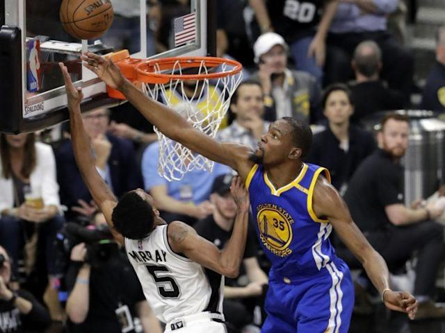 """<a class=""""link rapid-noclick-resp"""" href=""""/nba/players/4244/"""" data-ylk=""""slk:Kevin Durant"""">Kevin Durant</a> pulled off one of the best blocks you'll ever see against the Spurs. (AP)"""