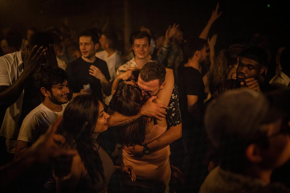 Two people hug in the middle of the dancefloor at Egg London on 'freedom day' (Getty)