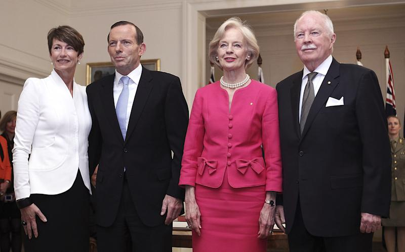 Tony Abbott, second from left, poses with his wife Margie, left, Governor General Quentin Bryce and her husband Michael for photographers after being sworn in as the 28th prime minister of Australia at Government House in Canberra Wednesday, Sept. 18, 2013. Abbott promised immediate action to slow the stream of asylum seekers arriving by boats from Indonesia and to repeal an unpopular carbon tax levied by the previous administration. (AP Photo/Stefan Postles, Pool)