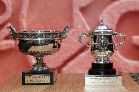 FILE PHOTO: The Musketeers' Trophy and the Suzanne Lenglen trophy are pictured during the draw ceremony for the French Open tennis tournament at the Roland Garros stadium in Paris, France, May 20, 2016. Picture taken May 20, 2016. REUTERS/Benoit Tessier