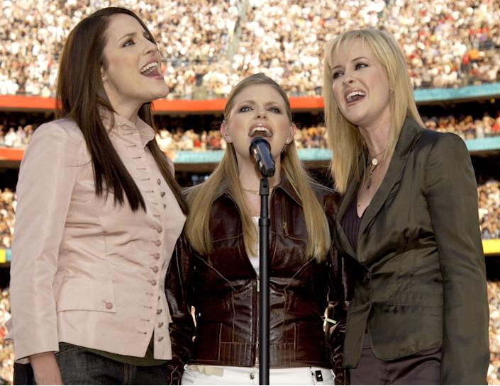 The Dixie Chicks sing the national anthem during Super Bowl XXXVII in San Diego, California on Jan. 26, 2003.
