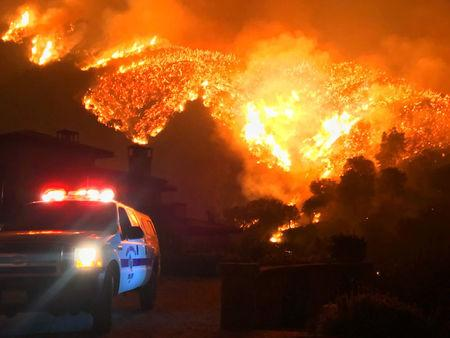 Thomas wildfire burns above Bella Vista Drive near Romero Canyon in this social media photo by Santa Barbara County Fire Department in Montecito California