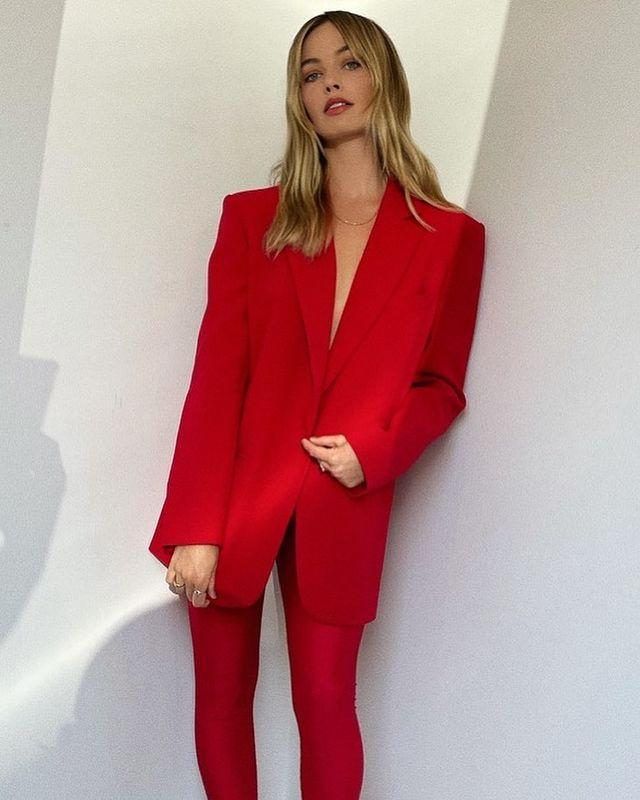 """<p>During her press tour for The Suicide Squad Margot Robbie stepped into some red leggings with a matching-hued blazer by <a href=""""https://theandamane.com/"""" rel=""""nofollow noopener"""" target=""""_blank"""" data-ylk=""""slk:The Andamane"""" class=""""link rapid-noclick-resp"""">The Andamane</a>. The blonde paired the look with a bold red lip and brown mules.</p><p><a class=""""link rapid-noclick-resp"""" href=""""https://go.redirectingat.com?id=127X1599956&url=https%3A%2F%2Fwww.farfetch.com%2Fuk%2Fshopping%2Fwomen%2Fandamane%2Fclothing-1%2Fitems.aspx&sref=https%3A%2F%2Fwww.elle.com%2Fuk%2Ffashion%2Fcelebrity-style%2Fg30889%2Fmargot-robbie-best-looks-style-in-pictures%2F"""" rel=""""nofollow noopener"""" target=""""_blank"""" data-ylk=""""slk:SHOP THE ANDAMANE NOW"""">SHOP THE ANDAMANE NOW</a></p><p><a href=""""https://www.instagram.com/p/CQY4gHZJKZ5/"""" rel=""""nofollow noopener"""" target=""""_blank"""" data-ylk=""""slk:See the original post on Instagram"""" class=""""link rapid-noclick-resp"""">See the original post on Instagram</a></p>"""