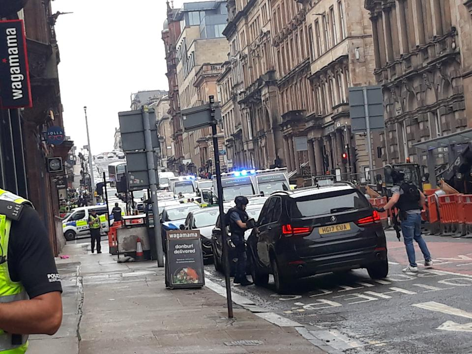 Photo taken with permission from the Twitter feed of @ThatReilz of police presence in West George Street, Glasgow, as a serious police incident has closed roads in the city centre. (PA)