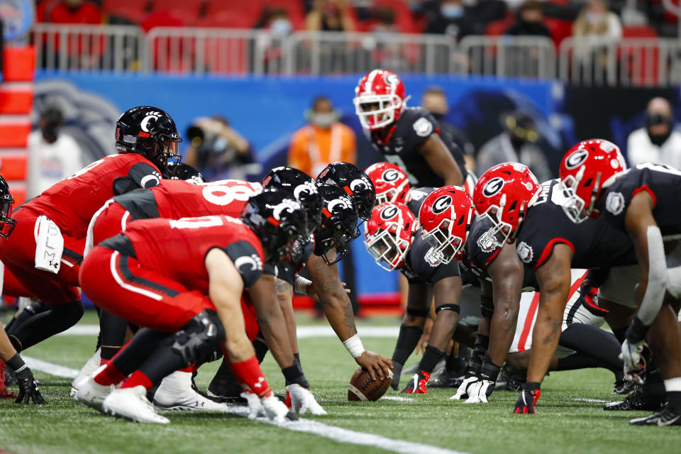 ATLANTA, GA - JANUARY 01: Desmond Ridder #9 of the Cincinnati Bearcats lines up under center during the first half of the Chick-fil-A Peach Bowl against the Georgia Bulldogs at Mercedes-Benz Stadium on January 1, 2021 in Atlanta, Georgia. (Photo by Todd Kirkland/Getty Images)