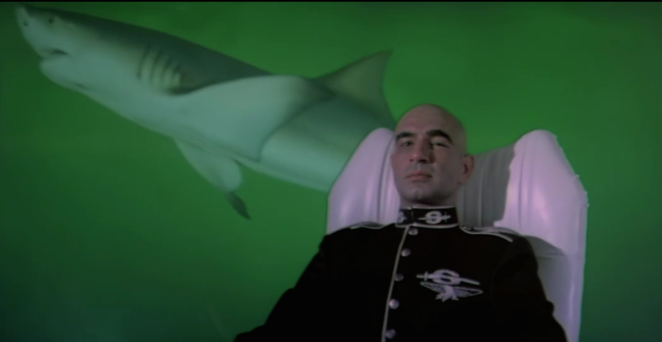 Kulbhushan Kharbanda's most famous role was inspired by Blofeld from the Bond films. The bald-headed military-styled international crime lord lives on a luxurious, high-tech island from where he controls his secret empire with the press of a few buttons on his dashboard. His loves his animals, too. The soft-spoken sadist loves to describe in gory detail what his pet crocodiles do to his enemies. And when the gators fail, Shakaal lets loose his pack of hungry dogs.