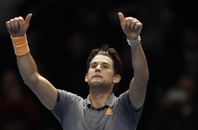 Austria's Dominic Thiem celebrates after defeating Serbia's Novak Djokovic in their ATP World Tour Finals singles tennis match at the O2 Arena in London, Tuesday, Nov. 12, 2019. (AP Photo/Alastair Grant)