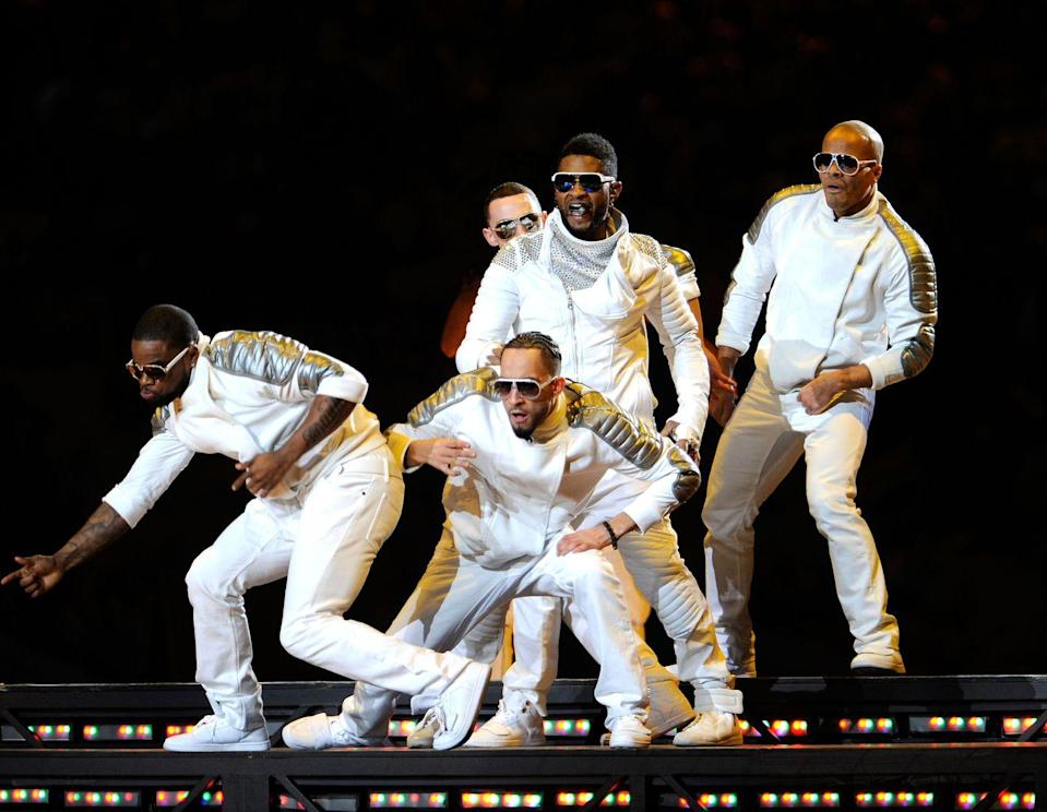 <p>Usher and his backup dancers look like they're about to climb into a spaceship and join the cast of Disney's <em>Zenon: Girl of the 20th Century</em>. And I don't hate it. </p>