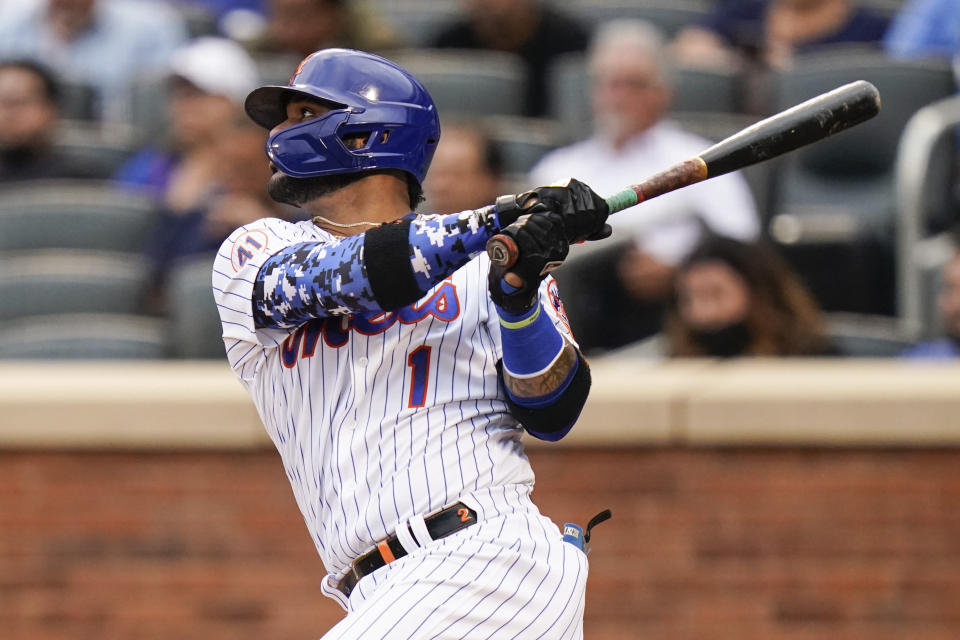 New York Mets' Jonathan Villar (1) hits an RBI single during the third inning in the first baseball game of a doubleheader against the Miami Marlins, Tuesday, Sept. 28, 2021, in New York. (AP Photo/Frank Franklin II)