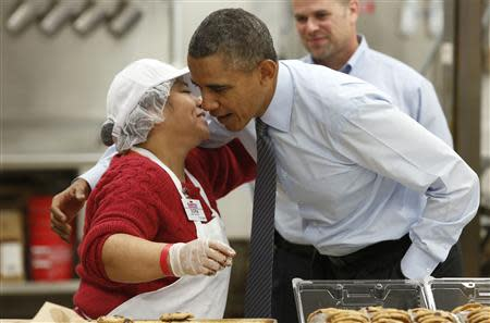 U.S. President Barack Obama greets a worker as he tours Costco Wholesale in Woodmore Towne Centre in Lanham
