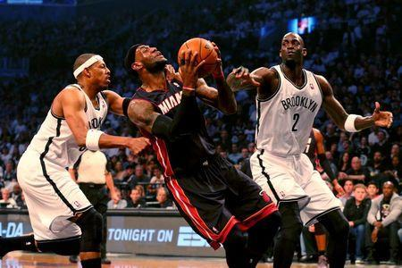 May 10, 2014; Brooklyn, NY, USA; Brooklyn Nets forward Paul Pierce (34) with a flagrant foul on Miami Heat forward LeBron James (6) during the first quarter in game three of the second round of the 2014 NBA Playoffs at Barclays Center. Mandatory Credit: Anthony Gruppuso-USA TODAY Sports