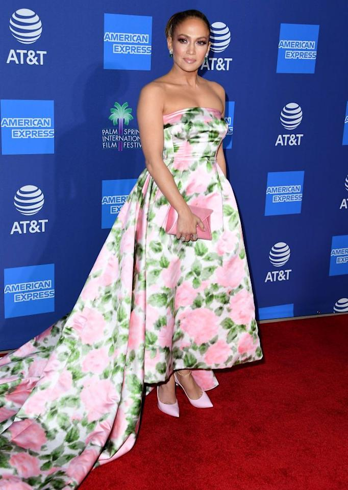"""<p>The 50 year-old star wore a Richard Quinn floral ballgown to pick up the Spotlight Award for her role in hit <a href=""""https://www.elle.com/uk/life-and-culture/a30177996/jennifer-lopez-reaction-to-fan-hustlers-plane/"""" target=""""_blank"""">Hustlers</a>. </p><p>Alongside her matching clutch and court heels the mother-of-two wore her hair in a large bun that totally reminded us of her character's iconic hairdo' in <a href=""""https://www.elle.com/uk/beauty/hair/a30387537/jennifer-lopez-hair-maid-in-manhattan/"""" target=""""_blank"""">Maid In Manhattan</a>. </p>"""