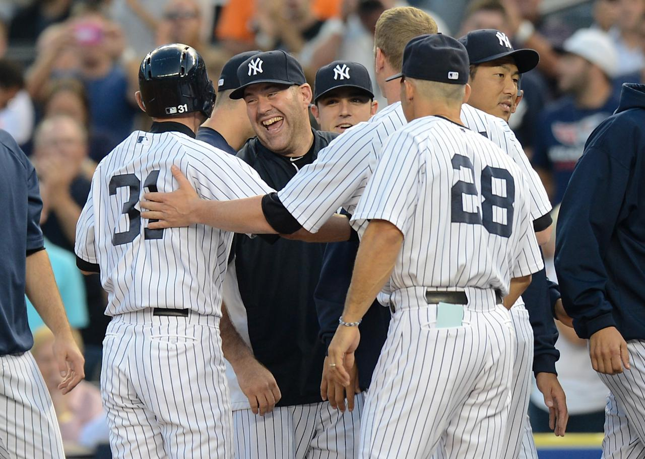 NEW YORK, NY - AUGUST 21: Ichiro Suzuki #31 celebrates with his team mates after his 4,000th career hit on a single in the 1st inning of the New York Yankees game against the Toronto Blue Jays at Yankee Stadium on August 21, 2013 in the Bronx borough of New York City. (Photo by Ron Antonelli/Getty Images)
