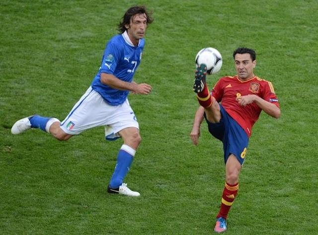 Italian midfielder Andrea Pirlo (L) vies with Spanish midfielder Xavi Hernandez during the Euro 2012 championships football match Spain vs Italy on June 10, 2012 at the Gdansk Arena. The game ended in a draw 1-1. AFPPHOTO/ PATRIK STOLLARZPATRIK STOLLARZ/AFP/GettyImages
