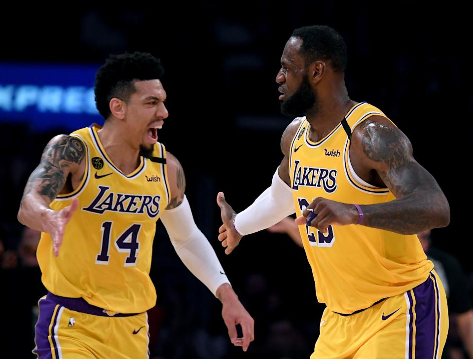 LeBron James of the Los Angeles Lakers celebrates his basket with Danny Green