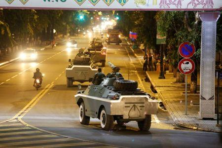 Army vehicles are seen along a street in Phnom Penh, Cambodia August 11, 2017. REUTERS/Stringer NO SALES NO ARCHIVES