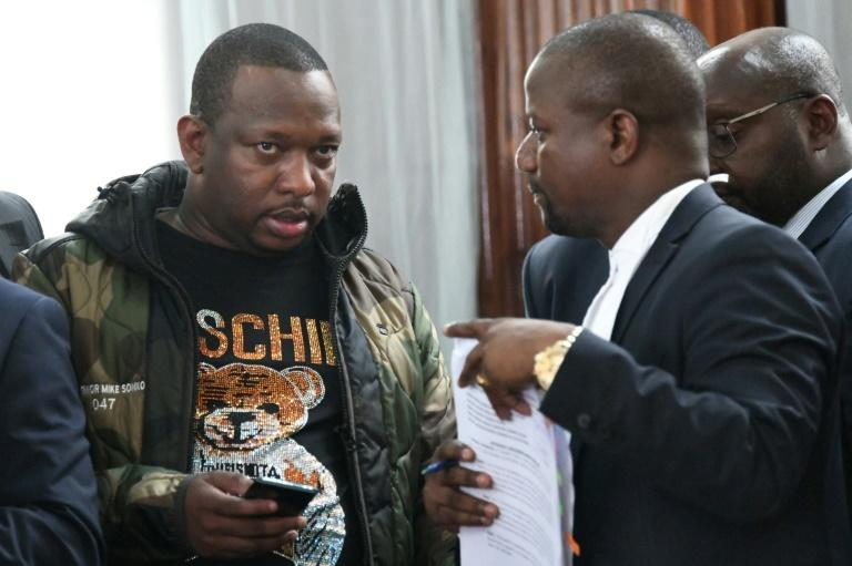 Nairobi Governor Mike Sonko, left, seen here in court in Nairobi on Monday, is known for his style mimicking an American rapper