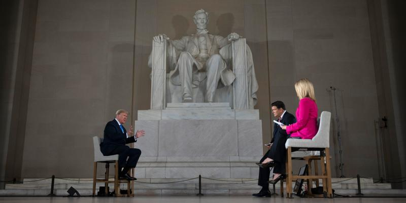 "US President Donald Trump speaks during a Fox News virtual town hall ""America Together: Returning to Work,"" event, with anchors Bret Baier (2nd R) and Martha MacCallum (R), from the Lincoln Memorial in Washington, DC on May 3, 2020. - Trump will answer questions submitted by viewers on Twitter, Facebook and Instagram. (Photo by JIM WATSON / AFP) (Photo by JIM WATSON/AFP via Getty Images)"
