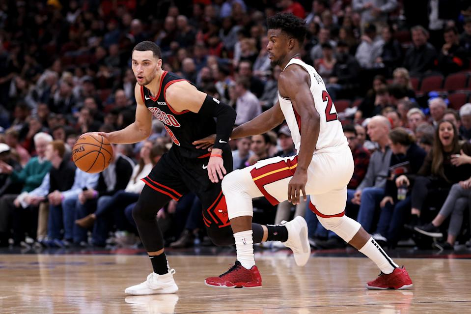 CHICAGO, ILLINOIS - NOVEMBER 22: Zach LaVine #8 of the Chicago Bulls dribbles the ball while being guarded by Jimmy Butler #22 of the Miami Heat in the fourth quarter at the United Center on November 22, 2019 in Chicago, Illinois. NOTE TO USER: User expressly acknowledges and agrees that, by downloading and or using this photograph, User is consenting to the terms and conditions of the Getty Images License Agreement. (Photo by Dylan Buell/Getty Images)