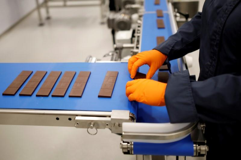 FILE PHOTO: Chocolate bars are sorted during a tour at a Canopy Growth facility