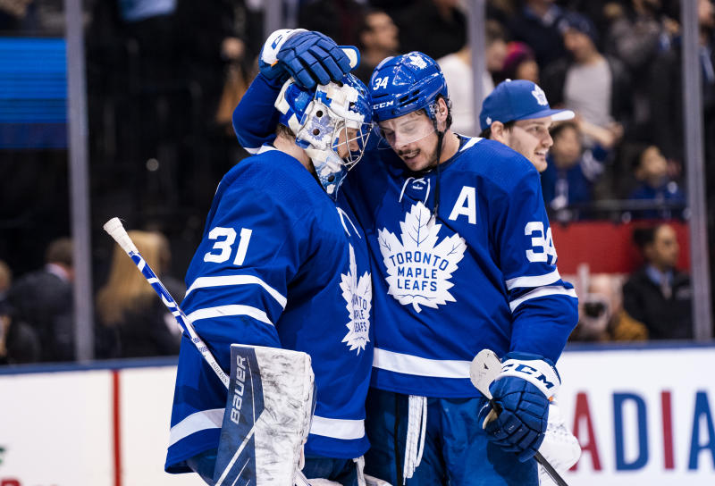 TORONTO, ON - DECEMBER 17: Frederik Andersen #31 of the Toronto Maple Leafs celebrates with teammate Auston Matthews #34 after defeating the Buffalo Sabres at the Scotiabank Arena on December 17, 2019 in Toronto, Ontario, Canada. (Photo by Kevin Sousa/NHLI via Getty Images)