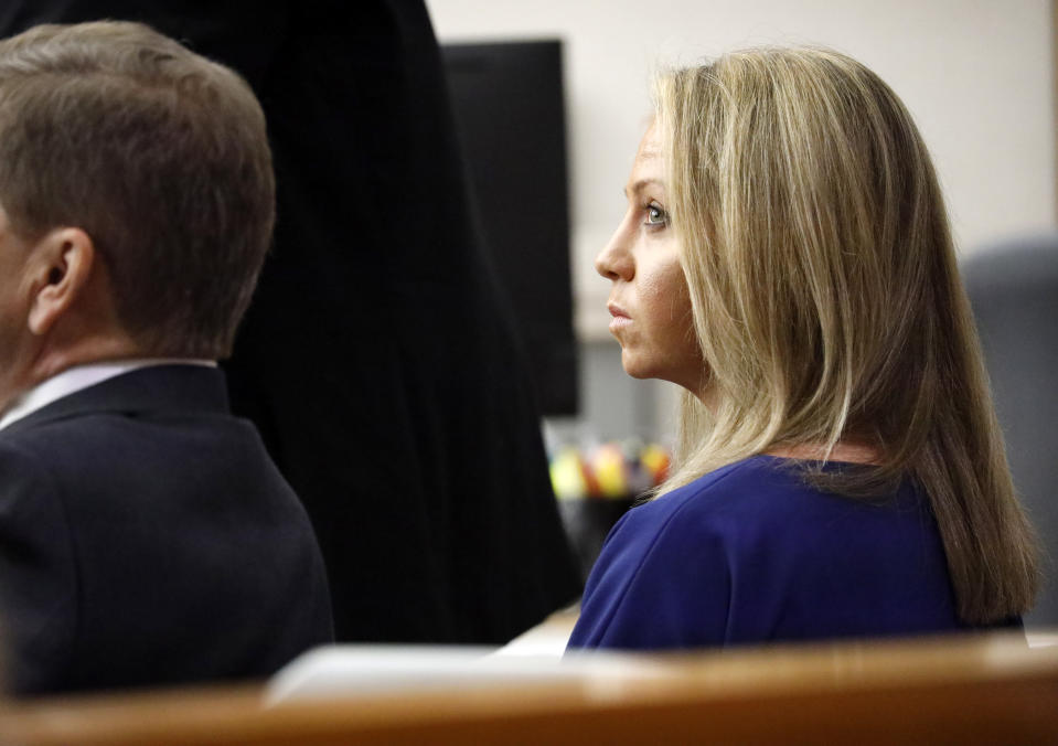 Former Dallas police Officer Amber Guyger listens to pretrial arguments in Judge Tammy Kemp's 204th District Court in Dallas, Monday, September 23, 2019. Guyger shot and killed Botham Jean, an unarmed 26-year-old neighbor in his own apartment last year. She told police she thought his apartment was her own and that he was an intruder. (Tom Fox/The Dallas Morning News via AP, Pool)