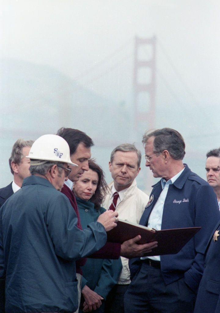 <p>Pelosi surveys the damage done by the Loma Prieta earthquake with President George H.W. Bush.</p>
