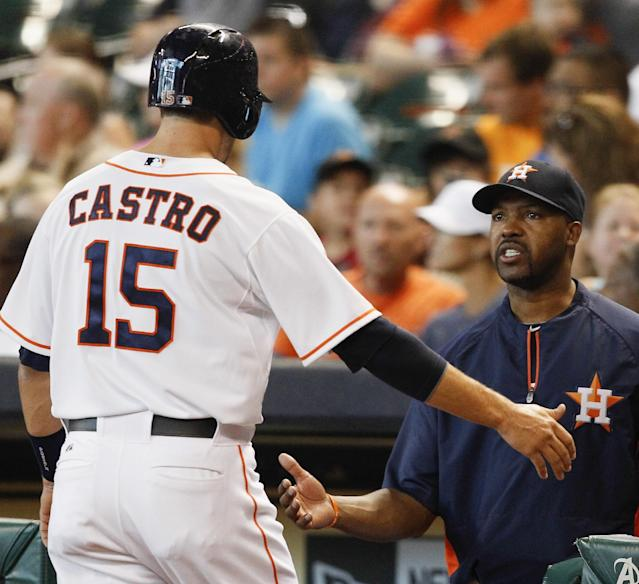 Houston Astros' Jason Castro receives congratulations from Houston Astros manager Bo Porter after scoring in the first inning of a baseball game against the Minnesota Twins, Monday, Sept. 2, 2013, in Houston. (AP Photo/Bob Levey)