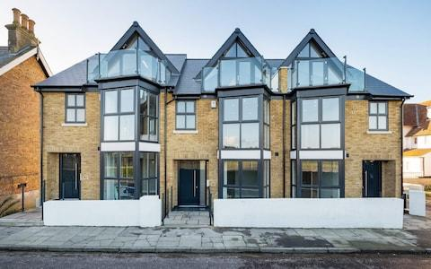 The townhouse's modern brick and glass exterior