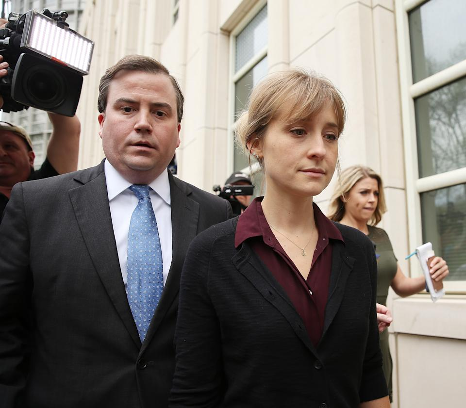 NEW YORK, NY - MAY 04:  Actress Allison Mack (R) departs the United States Eastern District Court after a bail hearing in relation to the sex trafficking charges filed against her on May 4, 2018 in the Brooklyn borough of New York City. The actress known for her role on 'Smallville' is charged with sex trafficking. Along with alleged cult leader Keith Raniere, prosecutors say Mack recruited women to an upstate New york mentorship group NXIVM that turned them into sex slaves.  (Photo by Jemal Countess/Getty Images)