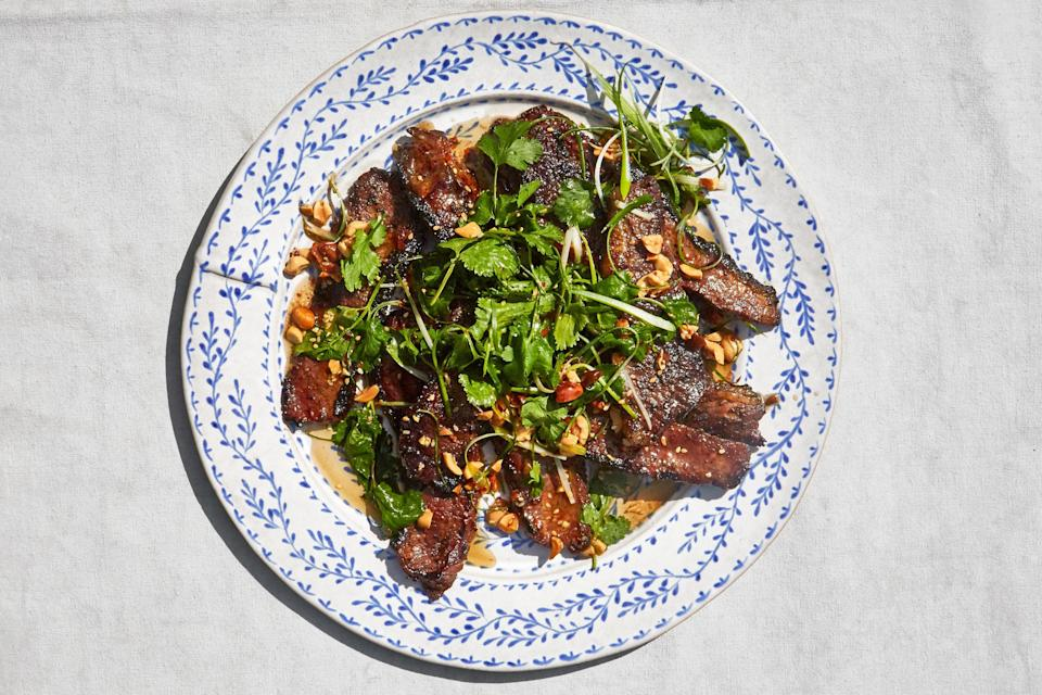 """It may seem like blasphemy to toss brisket onto a hot grill; but this method for thinly sliced, marinated meat results in flavorful, juicy steak strips for everyone. <a href=""""https://www.epicurious.com/recipes/food/views/grilled-beef-brisket-with-scallion-peanut-salsa?mbid=synd_yahoo_rss"""" rel=""""nofollow noopener"""" target=""""_blank"""" data-ylk=""""slk:See recipe."""" class=""""link rapid-noclick-resp"""">See recipe.</a>"""